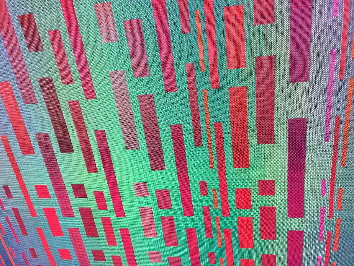 Red and green gradients in a double weave